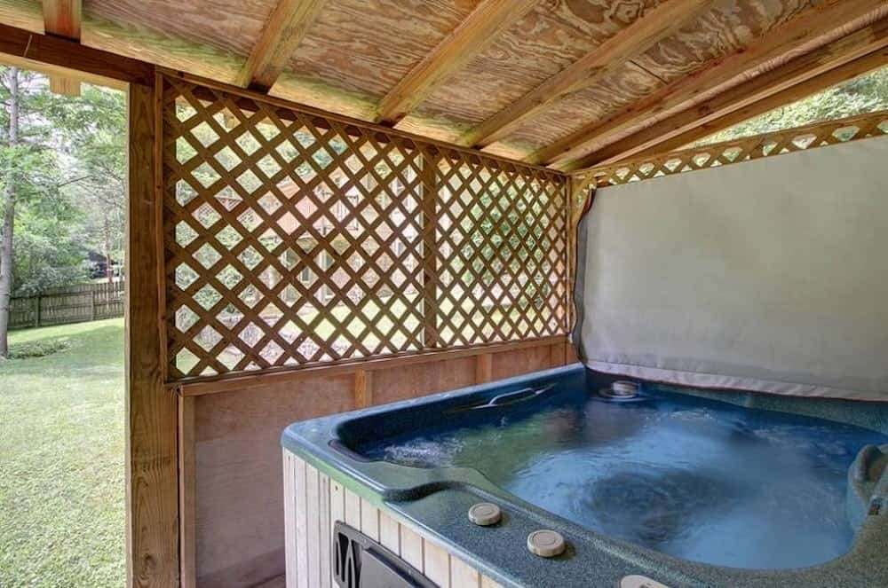 hot tub on porch of a place to stay in gatlinburg tn