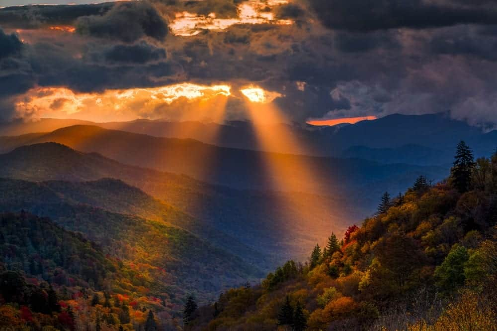 Light shines from behind the clouds in the Great Smoky Mountains.