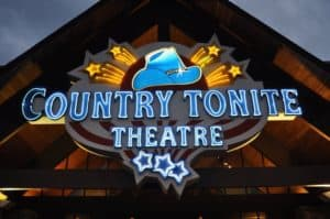 Sign for Country Tonite music show in Pigeon Forge lit up at night