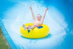 boy-on-slide-at-water-park