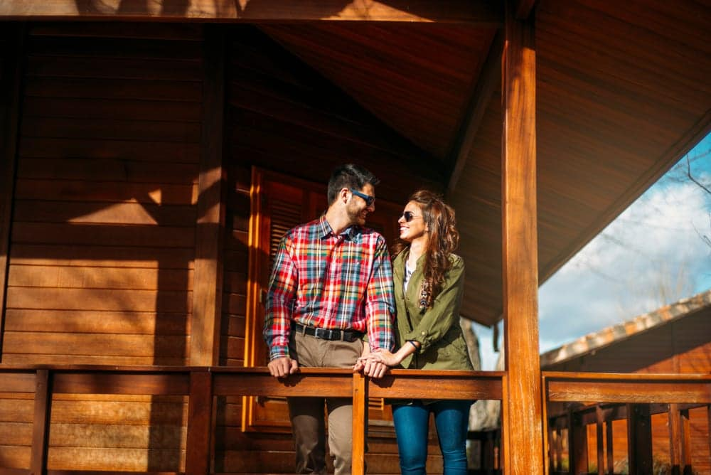 couple on the deck of a Gatlinburg cabin rental