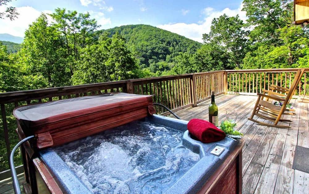 hot tub on deck of cabin in gatlinburg
